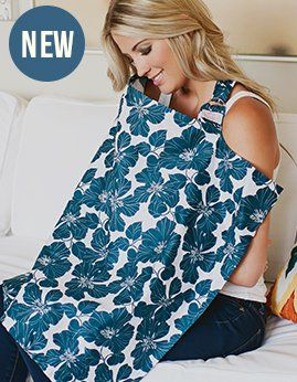 Udder Covers ™ ---Nursing cover.  There are lots of brands...  (You could even make your own?  I didn't..)