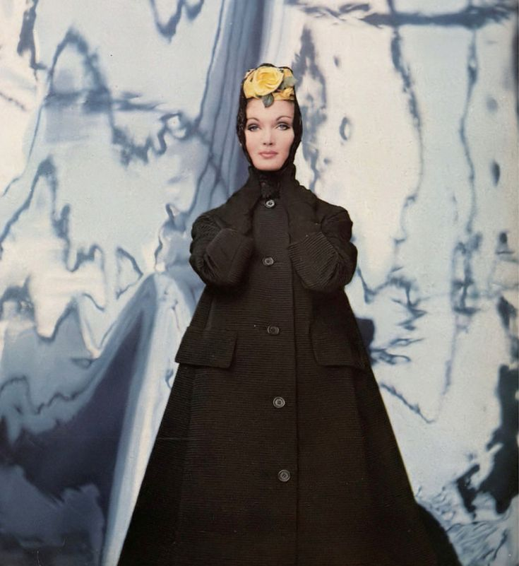 1959 Evelyn Tripp in triangular black ottoman coat with a cardigan collar by Originala, mantilla with yellow rose by Emily Wetherby