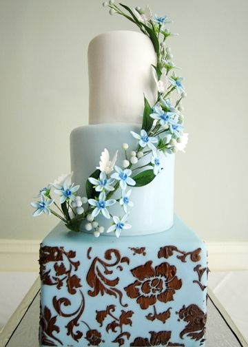 A Chocolate Brown Rose Pattern and Sugar Blue Tweedia Cascade on this Color Blocked Wedding Cake at The City Club de Rosset in Downtown Wilmington - Cake by Flower & Flour.