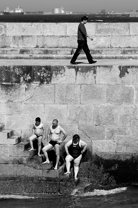 Henri Cartier-Bresson - Makes your eye move around the picture... the juxtaposition of the bathers and the dressed walker