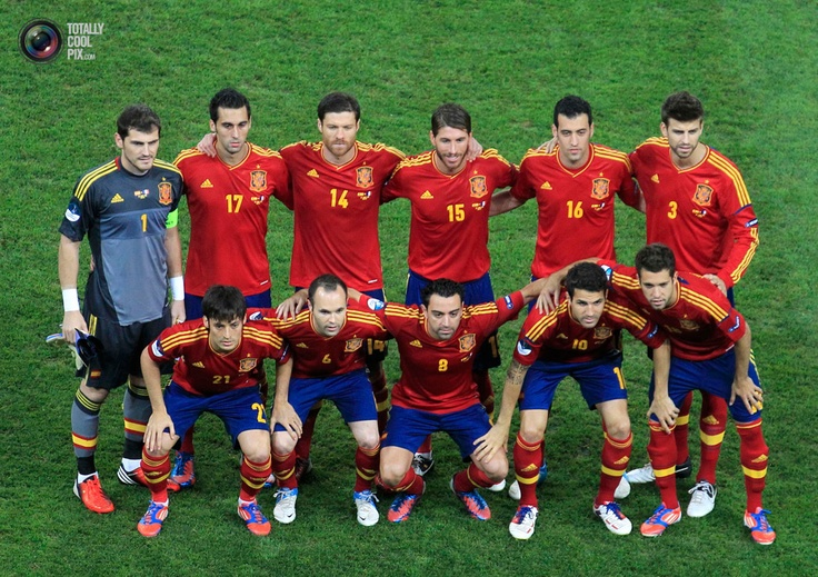 Players of team Spain pose for a team photo before the start of their Euro 2012 quarter-final soccer match against France at the Donbass Arena in Donetsk