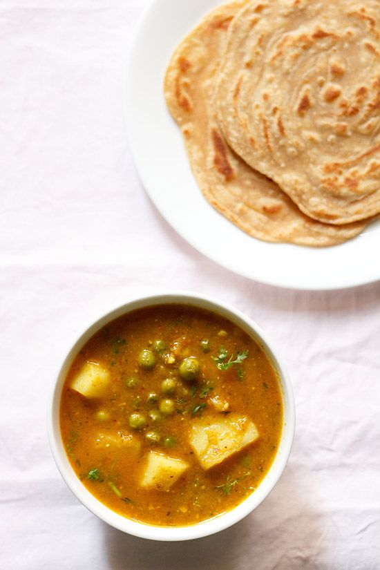 aloo matar curry recipe – a simple and home style recipe of punjabi peas and potatoes curry.  #curry
