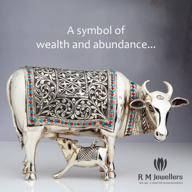 Delicately crafted silver idol of a cow and her calf...