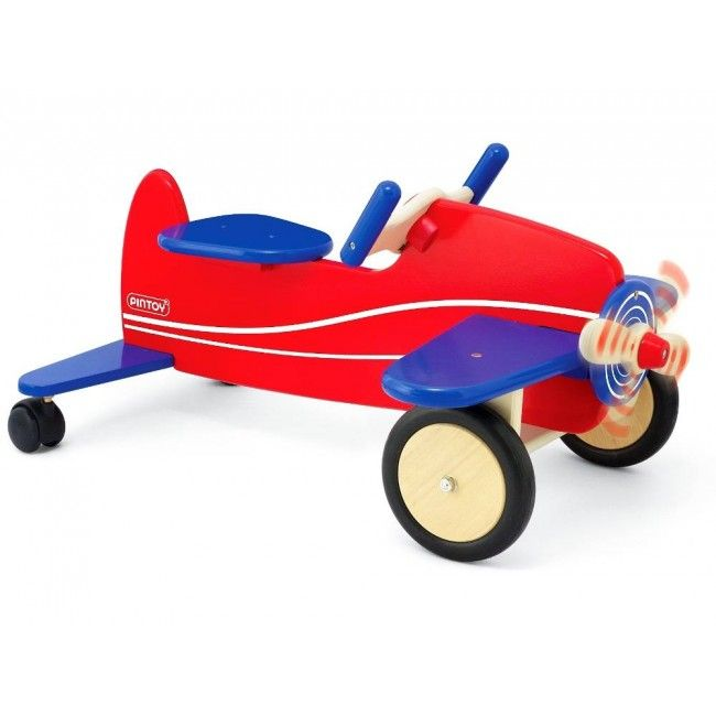 Children can let their imaginations fly with Pintoy's beautiful wooden ride-on aeroplane. The red and blue jet has four wheels (two at the front are rubber enforced for extra stability), a steering wheel and a spinning propeller at the nose of the plane. Suits children from 1-3 years #pintoy #woodentoy