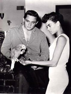 A young Johnny Cash with pet parrot and his 1st wife Vivian.