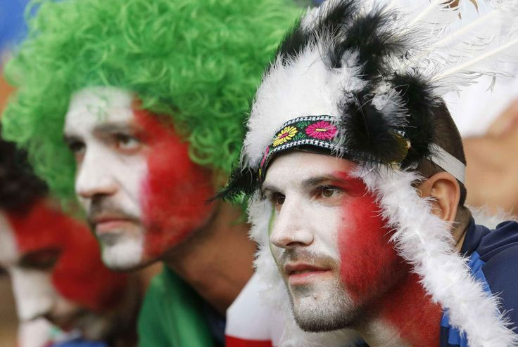 Italy fans wait for the beginning of the Euro 2016 quarterfinal soccer match between Germany and Italy, at the Nouveau Stade in Bordeaux, France, Saturday, July 2, 2016. (AP Photo/Michael Probst)/FOS102/630380921750/1607022040