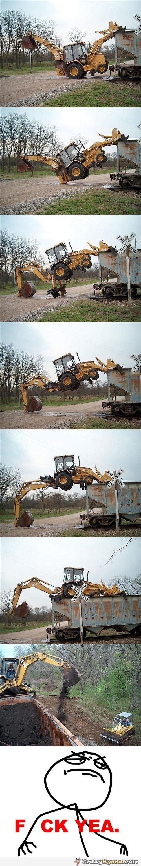 Funny excavator climbs on a wagon