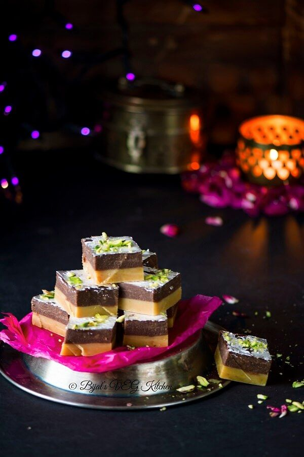 Two layer Chocolate Burfi perfect for kids made using milk powder,Chocolate.Its quick, easy and popular Indian sweet,perfect for gift too.If you love chocolate and if you love Indian sweets then this could be it.Also make sure it should be away from kids, else it will be vanished wid in a few mins.