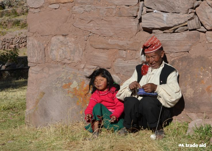 Jose Sebastiano, a traditional knitter from Taquille Island, Peru, sits with his grand-daughter Jacqueline. Fair trade - handmade change