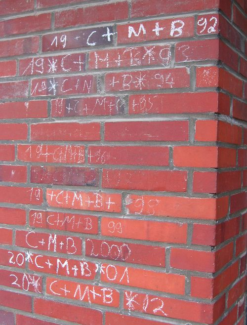 What is the Epiphany, how is the Epiphany celebrated in Germany, and why do the initials C + B + M get written on the walls of homes?
