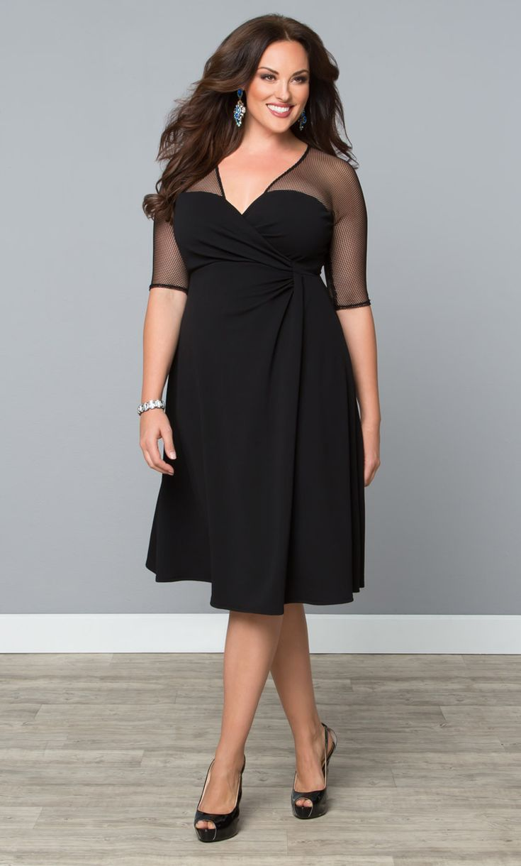 Stand out in a classic design with an edgy twist! Our Sugar and Spice Dress features a flattering A-line silhouette with a fashion-forward fishnet neckline. Gathering at the natural waist adds detail and gives this unique dress a faux wrap look.