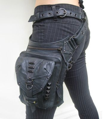 Black bag that sits on hip and thigh. Useful, don't have to carry on your arms, can get weapons out swiftly. Follow my board for more Post-apocalyptic ideas