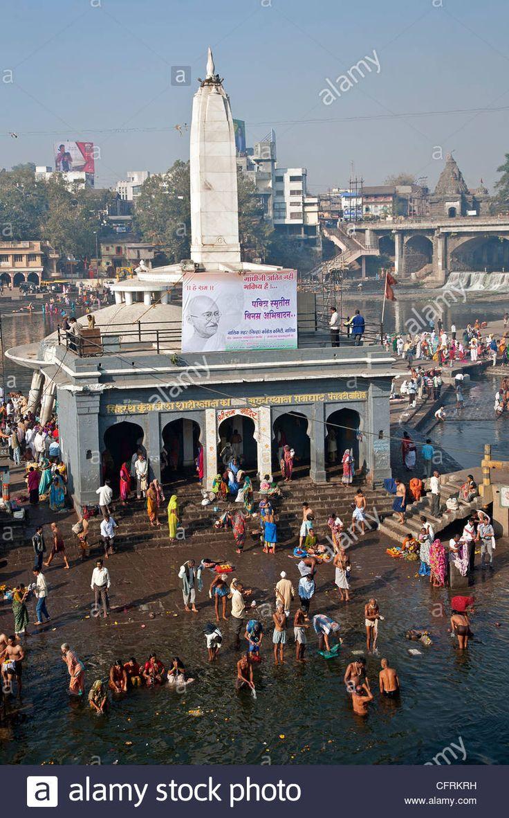 Hindu pilgrims bathing in the sacred waters of the Ram Kund. Godavari river. Nasik. India Stock Photo