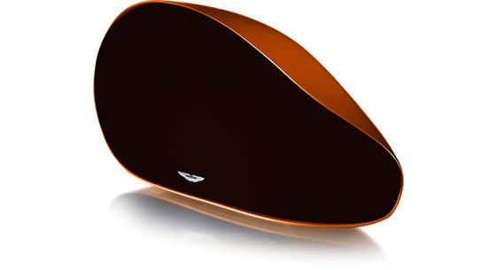 Aston Martin Zygote - a luxurious wireless audio system for your home. Here in Madagascar Orange with a Subtle Brown front grill