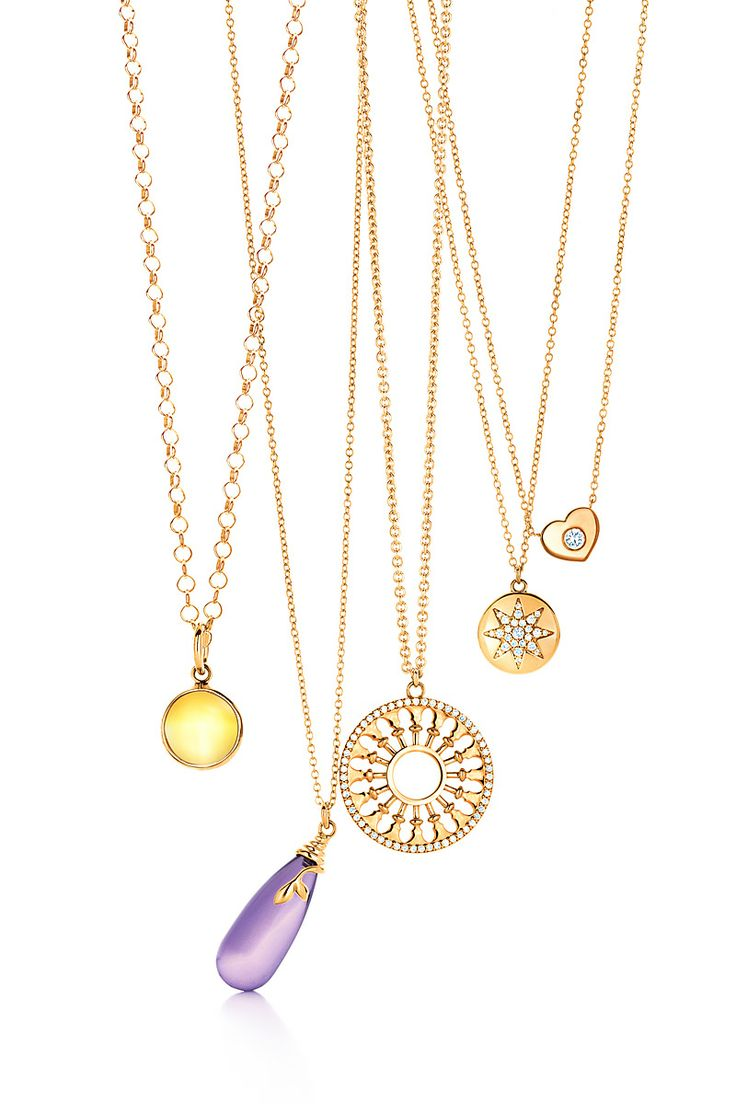 Paloma Picasso® citrine dot charm in 18k gold on the Paloma Picasso® round link chain, Paloma Picasso® Olive Leaf pendant in 18k gold with an amethyst, Paloma's Venezia Stella medallion pendant in 18k gold with diamonds, Paloma's Venezia Stella pendant in 18k gold with diamonds, Modern Heart pendant in 18k gold with a round brilliant diamond. #TiffanyPinterest