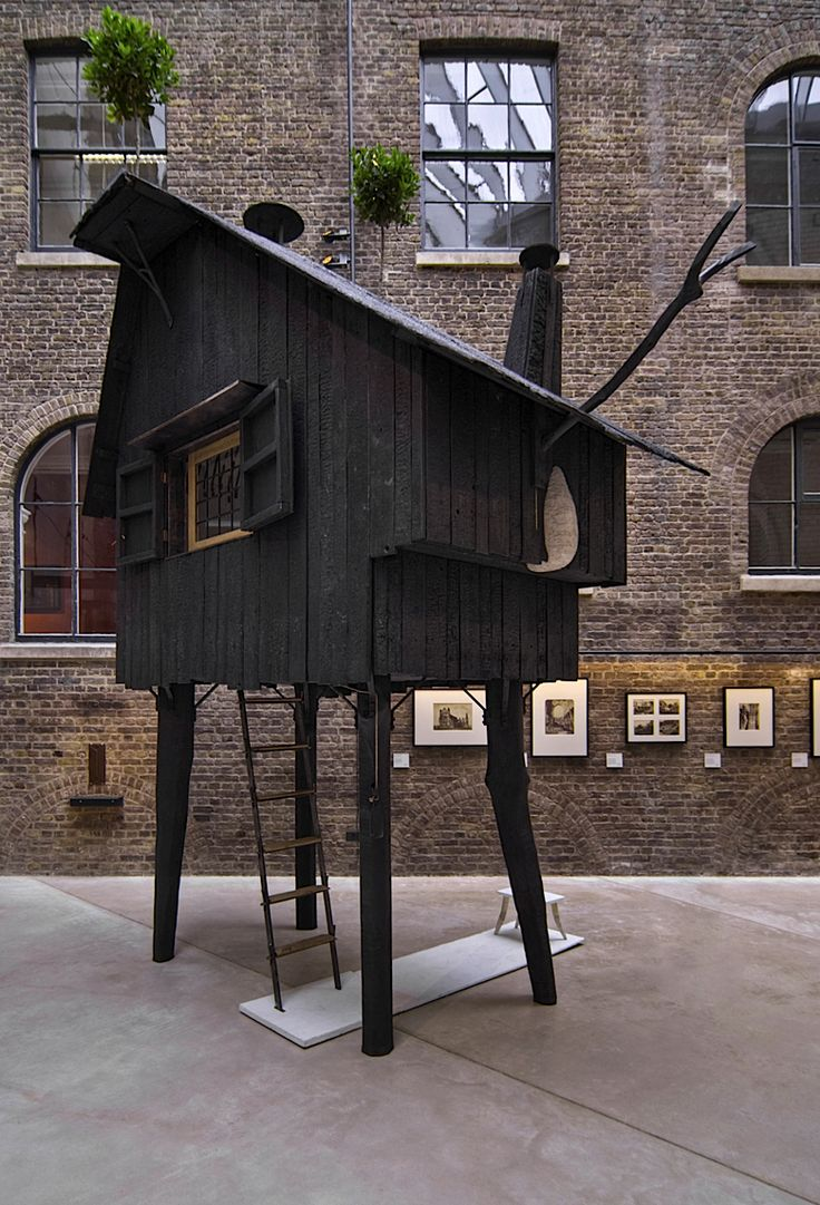 the Beetle's House by Japanese designer Terunobu Fujimori is very much like its name suggests: a wooden cottage held aloft by dangling beetle legs.