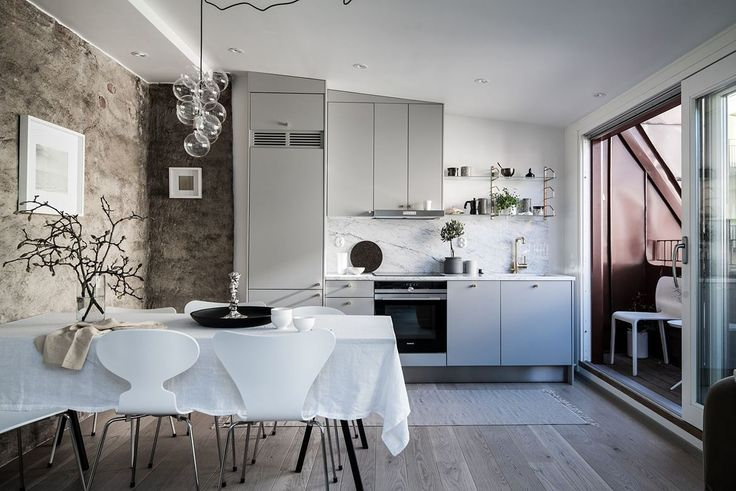 Modern grey kitchen with marble and concrete wall