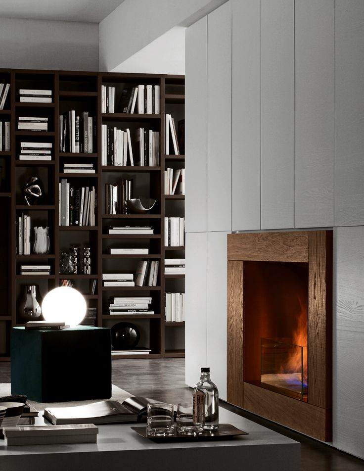"PRESOTTO | Pari & Dispari bookcase with swing doors and integrated bioethanol fireplace in tabacco ""aged"" oak. _ Libreria Pari & Dispari con ante battenti e caminetto a bioetanolo integrato in rovere vissuto tabacco."