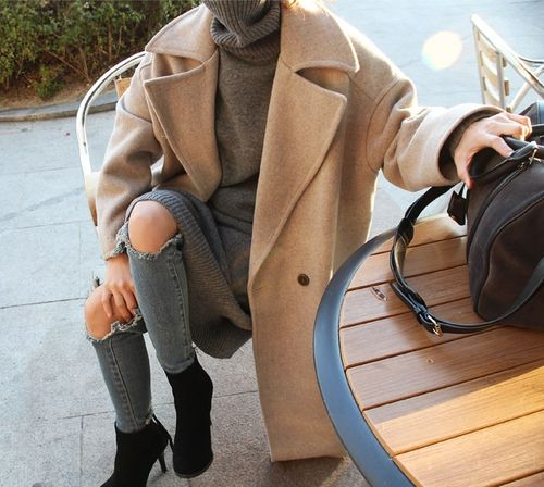 Over ripped but still stylish with the oversize camel coat and turtleneck sweater