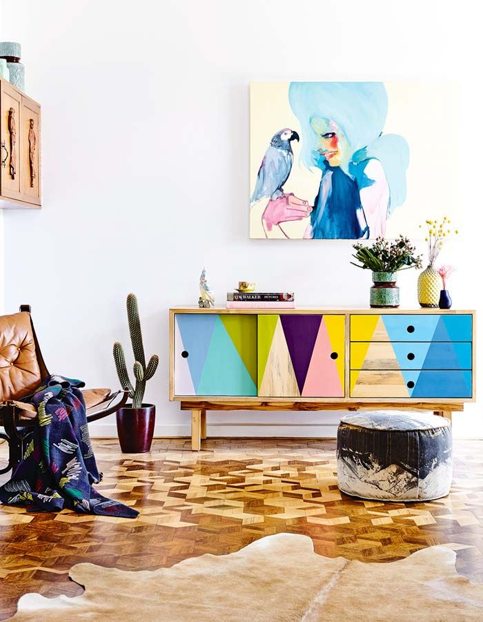 Light blue walls, light floor, so many bright and colorful accent pieces