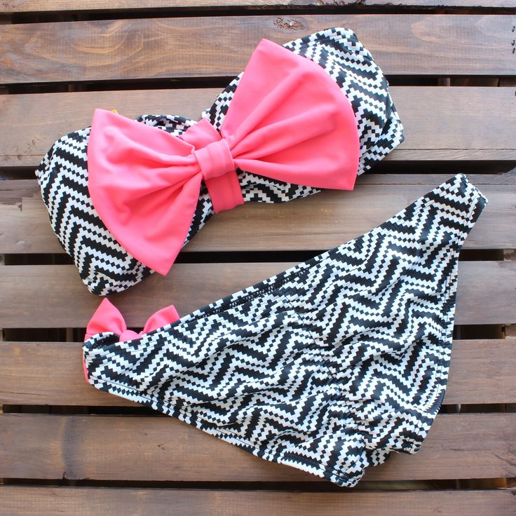 Two piece bandeau featuring a black and white chevron neon pink bow bra with removable soft cups. Includes detachable straps. Scrunch butt bottom. Fully lined. 80% nylon, 20% spandex. This amazingly t