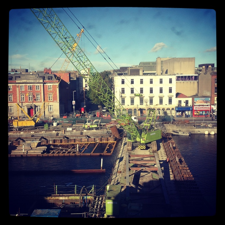 View from our office today - we love the Oxfam green crane! This is the construction site of the new bridge that will connect the Red & Green Luas lines at Burgh Quay in Dublin. http://www.oxfamireland.org