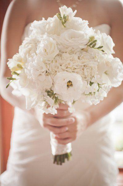 Love all white & ivory.  Peony Flower Arrangements Wedding Flowers Photos on WeddingWire