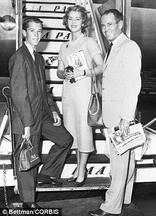 PanAm:Actor Henry Fonda and his children Peter and Jane board a flight to Europe at Idlewild Airport in 1957