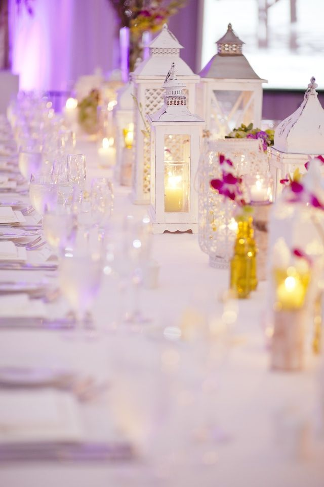 White lanterns and pretty flowers make for a romantic setting