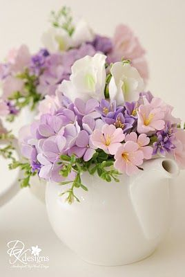 Those flowers are cherry blossoms, lavender hydrangeas, lavender hyacinth, pink and white sweet peas. (DK designs)