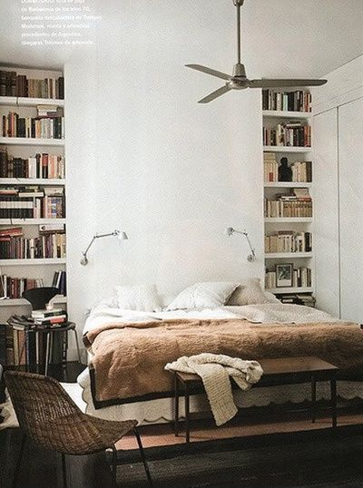 You can build out the wall to recess the bookshelves that flank the bed. via Indoors / Outdoors
