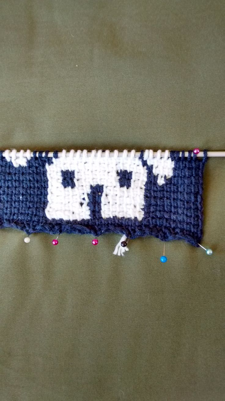 using the thin navy yarn with tricot crochet.