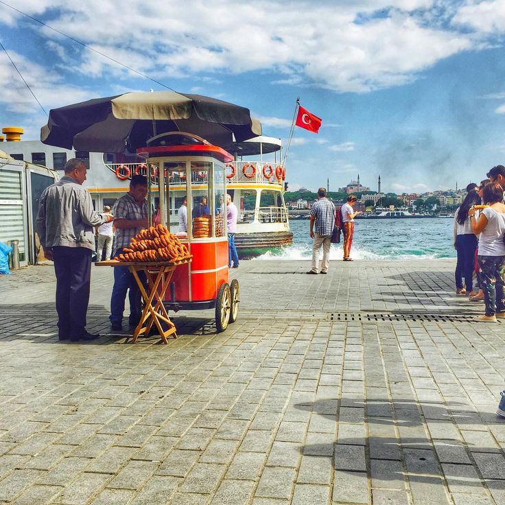 View from Starbucks, Karaköy. A simit (Turkish bagel) seller, people waiting for the ferry and Hagia Sophia backwards. For other tips and advices during your Istanbul trip (WhatsApp: +90 532 2104901) Only 1 Usd/ per day