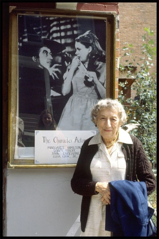 The Wizard of Oz. Here's Margaret Hamilton in later years posing in front of a photo from The Wizard of Oz. She played Miss Gulch and The Wicked Witch of the West.