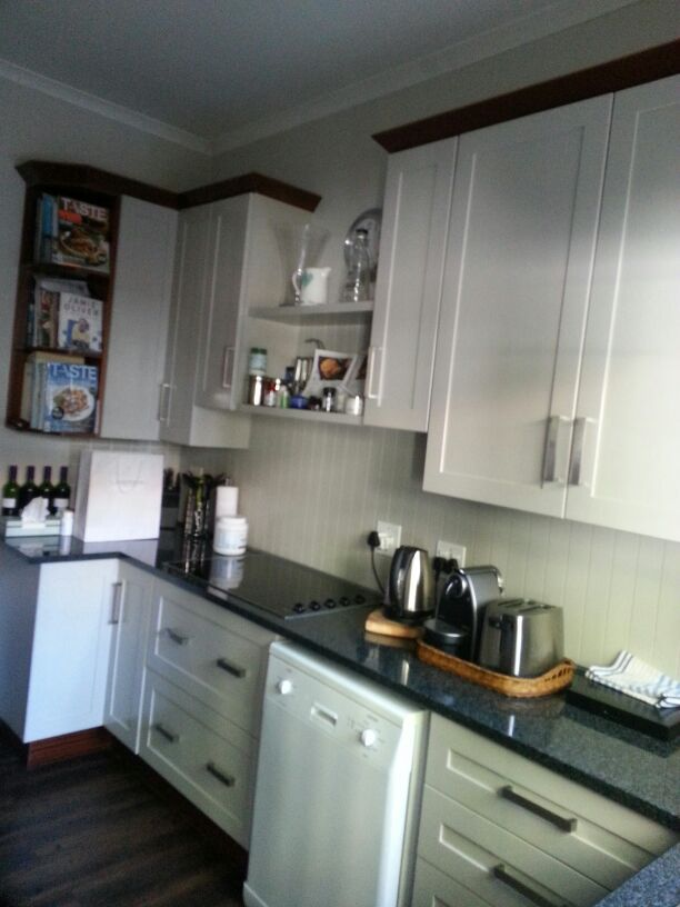 Clare's Kitchen. I really love the tounge and groove splash backs and the dark solid wood kick plates and cornices.
