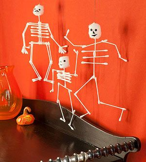 Swab Skeletons: Make no bones about it: this is a spellbinding Halloween party craft! Cover a work area with plastic wrap, then set out cotton swabs, cotton balls, black paper, and glue. Using plenty of glue, your guests can build skeletons from the swabs, cutting them into different lengths as needed, then attach cotton ball skulls and black paper faces. When the glue is dry, the skeletons can be hung up with thread.