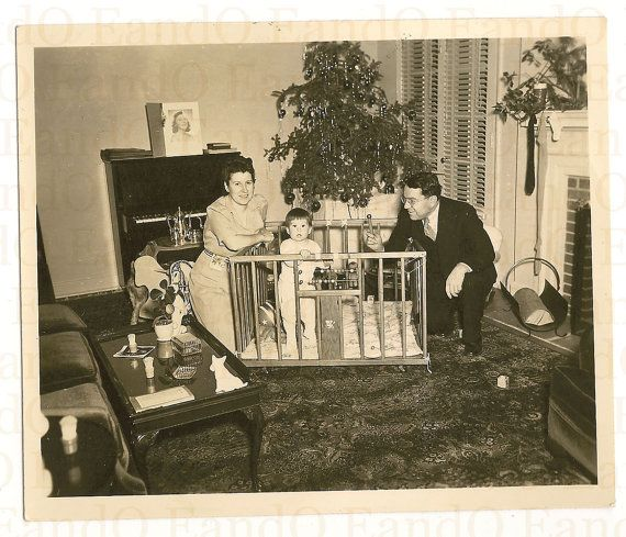 Vintage Christmas Photo ~ Little boy in his playpen on Christmas with his parents by the tree. Notice their real stockings hung on the tree. Mom was smart and used one of her own. Circa 1940's.