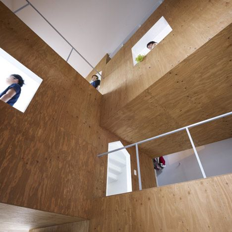 This house in Hiroshima city by Japanese firm Suppose Design Office has a central staircase branching into wooden volumes that create a series of rooms and platforms.