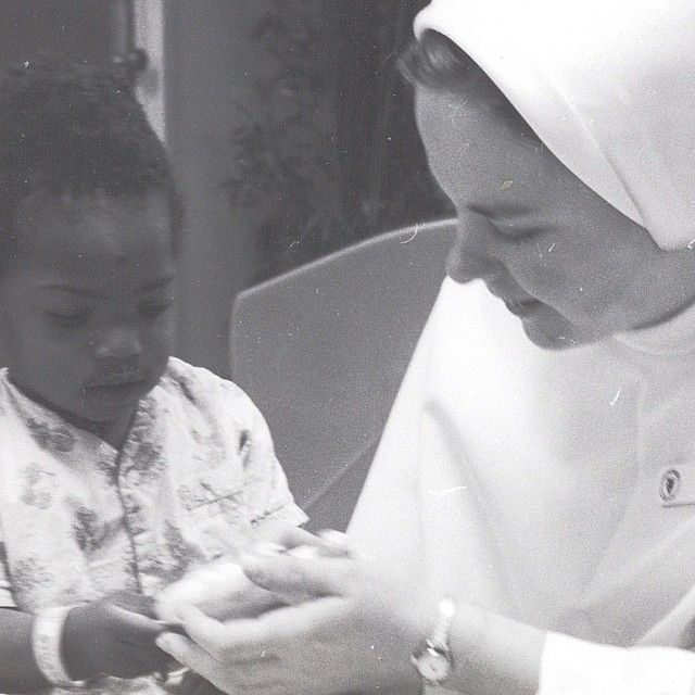 A Dominican Sister with a young patient at St. Dominic Hospital.