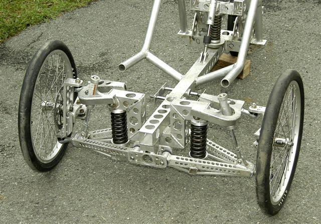 Pictures of homebuilt fully suspended aluminum trike of Julian Edgar from TrikesDigest Quotes from builder: OK. I've been for two decent rides on new trike. Problems are:- Dampers rattle. Tha…