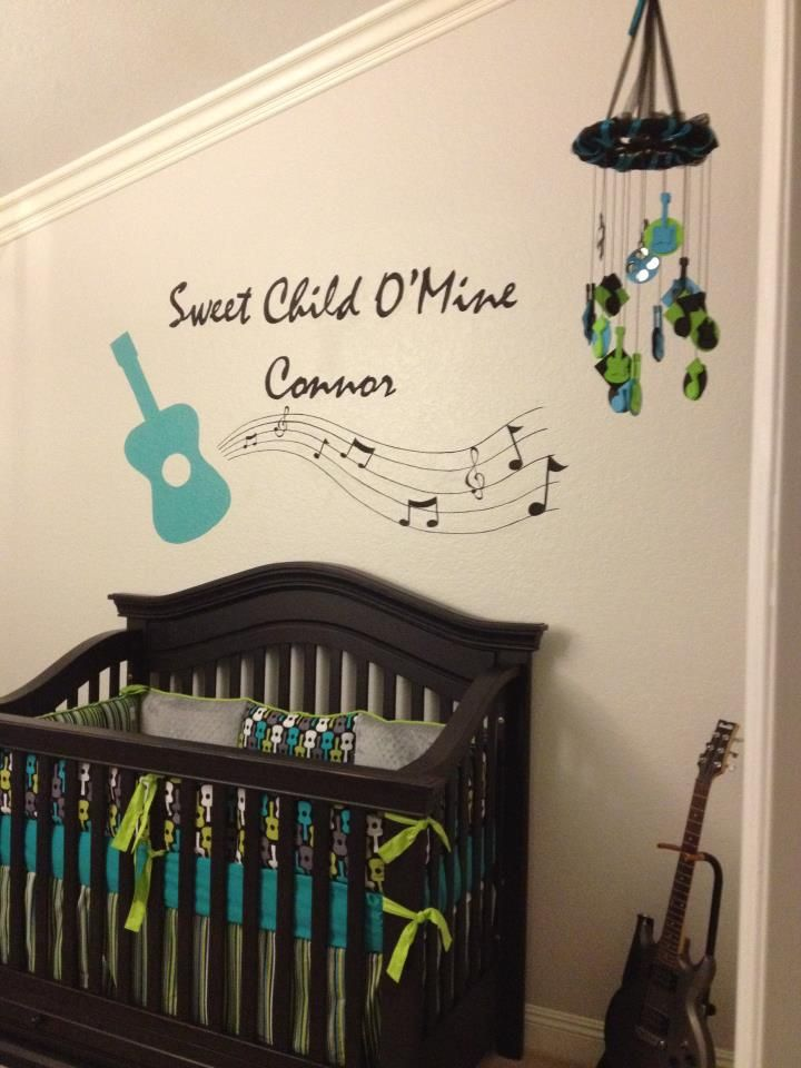 Rock N Roll nursery in green, aqua and grey with Michael Miller Groovy Guitar fabric.