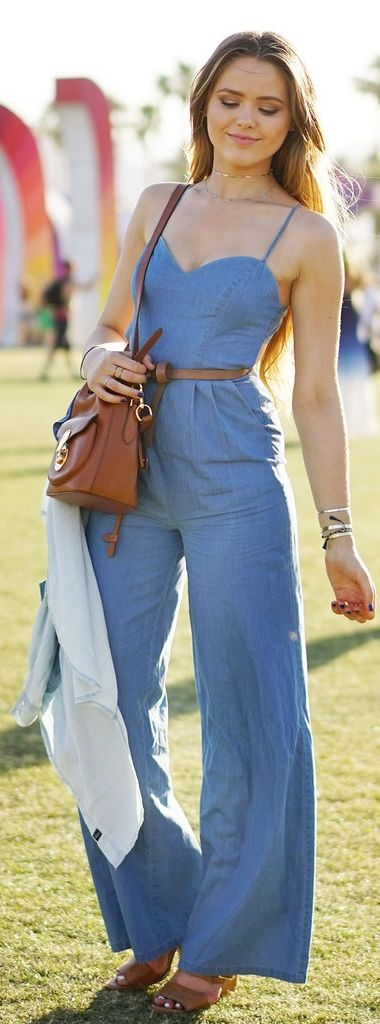 The perfect denim jumpsuit got topped off with neutral wedges, a skinny belt, and a midsize crossbody bag at Coachella.