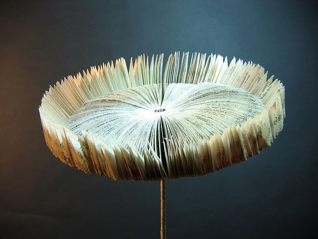 Book Art Sunflower by artist Helen Smith. Made from a piece of a chunky thriller (the last page was missing!). via Helen~S on flickr
