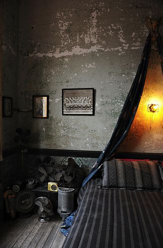 bedroom/ vintage fans, distressed concrete walls