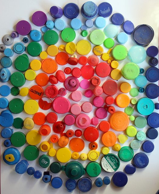 Let the kids bring plastic lids and other 'stuff' in all colors and assemble a rainbow