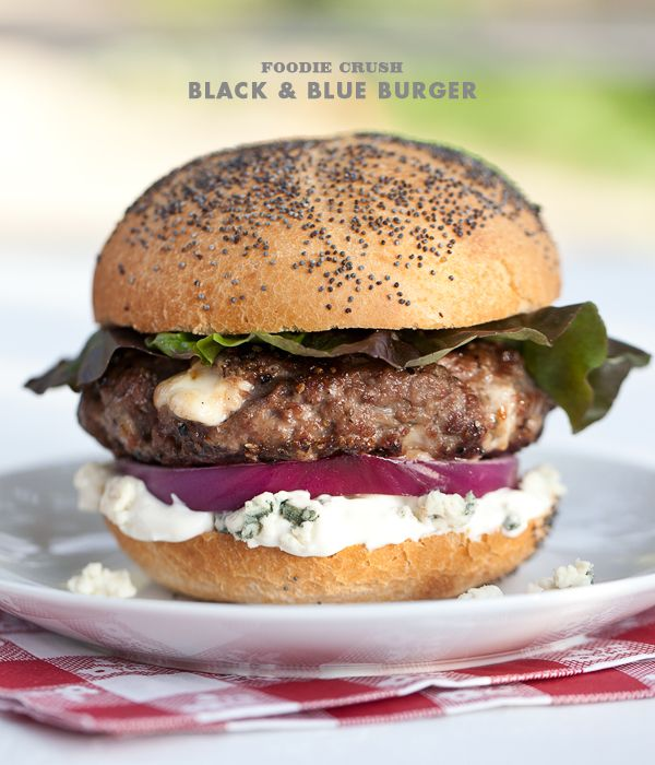 Black & Blue Burger...1 pound 85% lean ground beef  1 teaspoon salt Freshly ground black pepper 1 cup Wisconsin Blue Cheese, crumbled, divided 1/2 cup mayonnaise 1/2 cup sour cream 3 hamburger or brioche buns Red onion sliced and leaf lettuce or condiments as desired