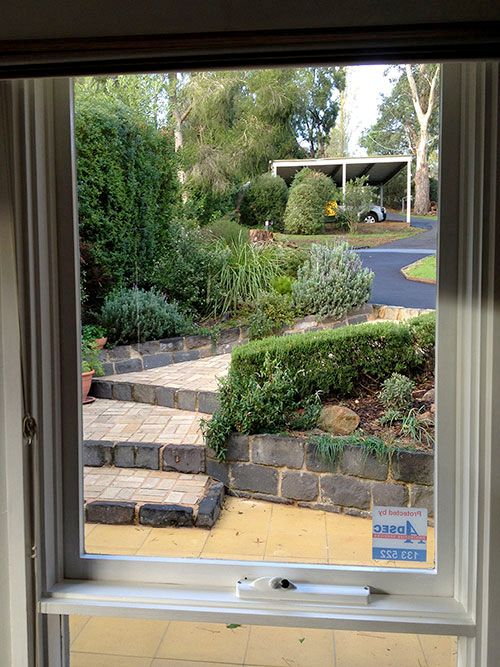 This time a shot from the interior looking out to the garden. This showcases the bluestone kerb landscaping (those blocks weigh 20kg apiece! BTW) and garden design. The bed nearest the house provided herbs for the kitchen with a low water-usage Australian native flower garden located behind.
