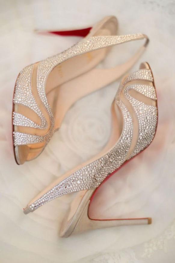 Weddbook ♥ Ivory Christian Louboutin peep toe wedding pumps with swarovski crystal details and red sole. silver glitter sparkle louboutin peeptoe crystal ivory