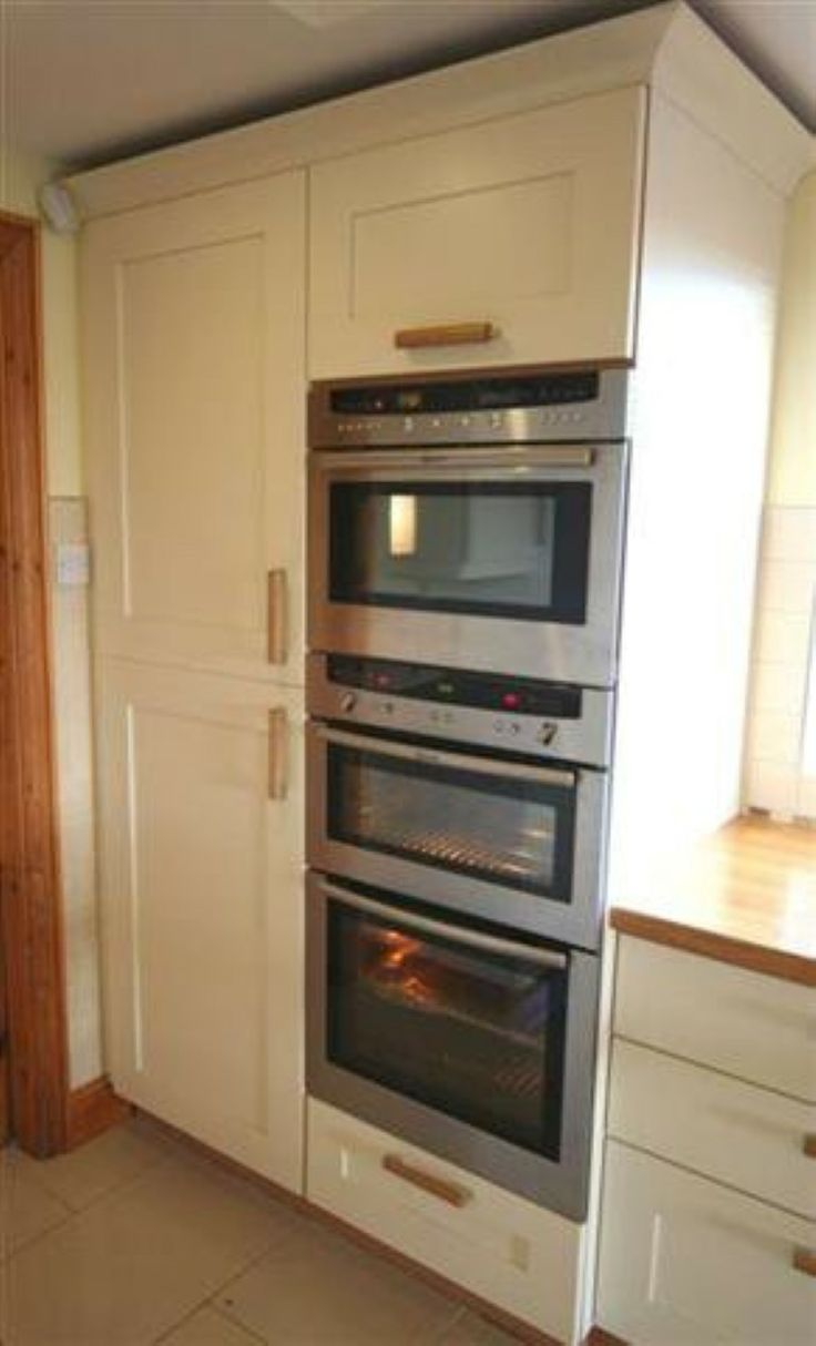 painted kitchen with eye level ovens http www