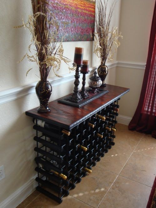 Some type of wine rack.  I can't believe we don't have one since we are such wine fanatics!!  If wood, then def cherry stain!